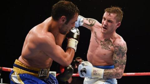 Ricky Burns throws a right at Italy's Michele Di Rocco