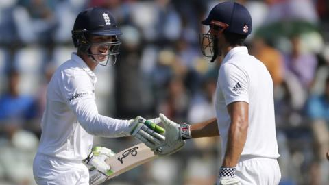 England captain Alastair Cook congratulates Keaton Jennings on his half-century