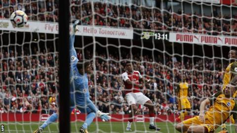 Wenger marks 21-year anniversary with win over Brighton