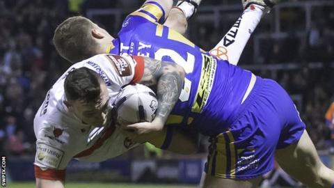 Leeds' Ash Handley upends St Helens' Matty Dawson