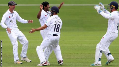 Jeevan Mendis of Derbyshire celebrates with Alex Hughes and team mates after Colin Ingram of Glamorgan is caught by Gary Wilson