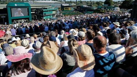 Fans watch Andy Murray from the sunny delights of Henman Hill