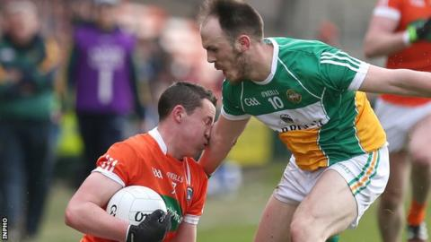 Armagh defender Charlie Vernon feels the impact of this challenge from Offaly's Graham Guilfoyle