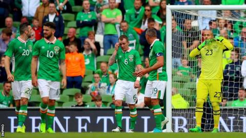 Darren Randolph (right) after gifting Uruguay their goal in Sunday's game in Dublin