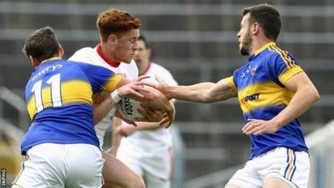 Tyrone's Conor Meyler is tackled by Tipperary's Conor Sweeney in Thurles