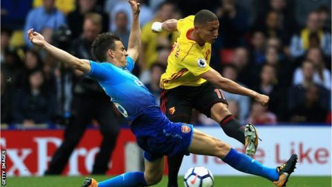 Arsenal defender Laurent Koscielny tries to block a shot from Watford's Richarlison (right)