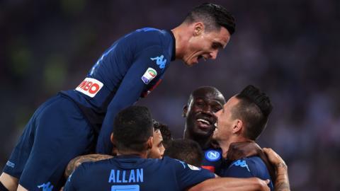 Napoli's players celebrate scoring against Lazio