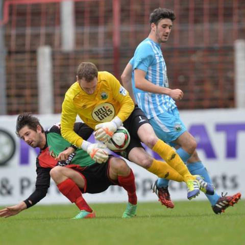 Glentoran striker Curtis Allen is thwarted as Warrenpoint keeper Jonathan Parr collects the ball at the Oval