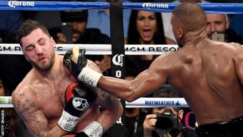 Nathan Cleverly (left) is hit by Badou Jack