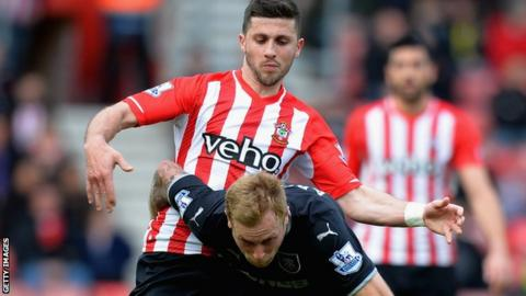 Southampton's Shane Long challenges Burnley's Scott Arfield