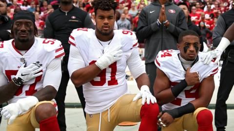 San Francisco 49ers kneeling
