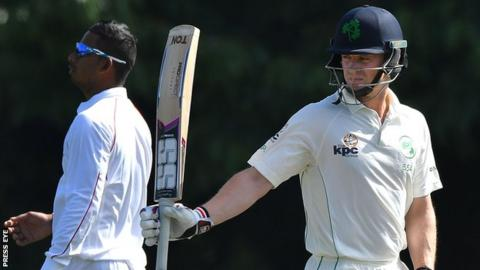 William Porterfield acknowledges applause after reaching his 50 at Stormont