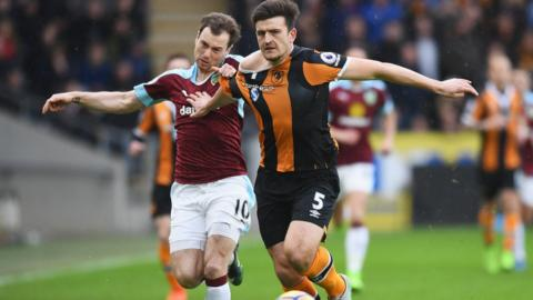 Ashley Barnes battles with Harry Maguire