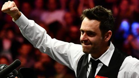 Ronnie O'Sullivan celebrates beating Marco Fu