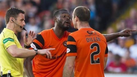 Wato Kuate argues with Dundee United captain Sean Dillon at referee Steven McLean looks on