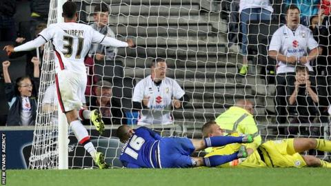 Josh Murphy of MK Dons slots home the winning extra-time goal