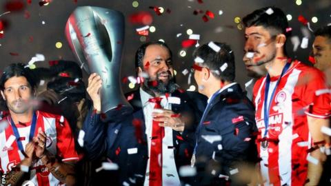 Evangelos Marinakis celebrates Olympiakos winning the Greek Superleague