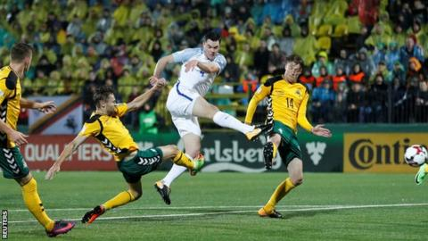 England defender Michael Keane takes a shot during his appearance against Lithuania