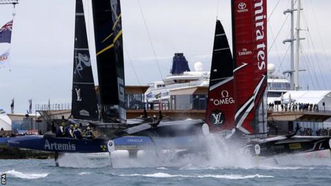 Emirates Team New Zealand crosses the finish just ahead of Artemis Racing