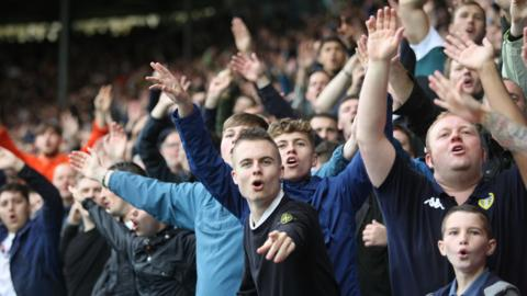 Leeds fans celebrate a goal