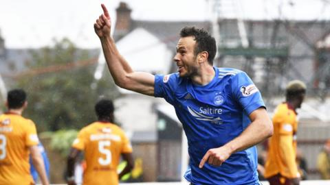Andrew Considine celebrates his opener
