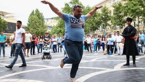 A man dances in the centre of azerbaijan's capital, Baku