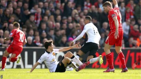 Manchester United's Ander Herrera (left) and Liverpool's Steven Gerrard