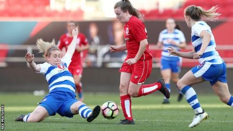Lauren Hemp of Bristol City Women is tackled by Rachel Furness of Reading