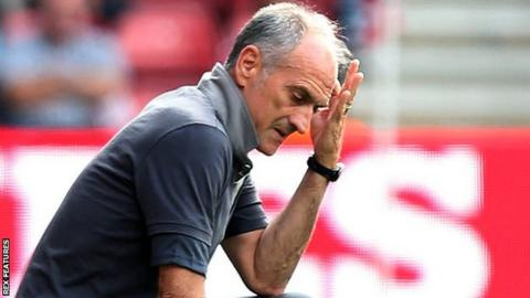 Francesco Guidolin averts his gaze during Swansea's defeat at Southampton
