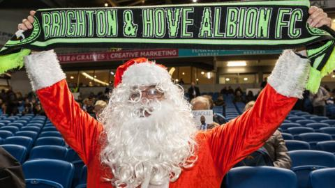 Brighton fan in Santa outfit