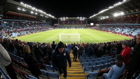 Aston Villa fans head for the exits during the match against Everton