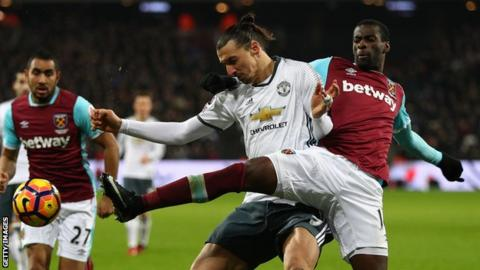Pedro Obiang tussles for the ball with Zlatan Ibrahimovic of Manchester United