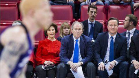 George W Bush and David Cameron at a basketball game