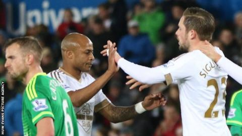 Andrew Ayew and Gylfi Sigurdsson celebrate a Swansea goal