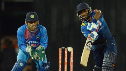 India's MS Dhoni and Sri Lanka's Ashan Priyanjan