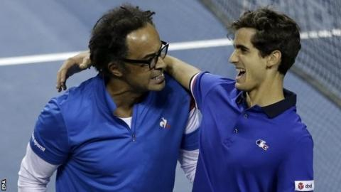 France captain Yannick Noah (left) celebrates with Pierre-Hugues Herbert after their victory in Tokyo