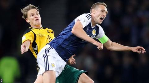 Lithuania's Vykintas Slivka tackles Scotland's Darren Fletcher