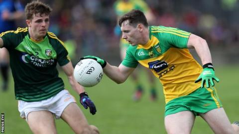 Antrim's Conor Hamill prepares to challenge Donegal goalscorer Jamie Brennan
