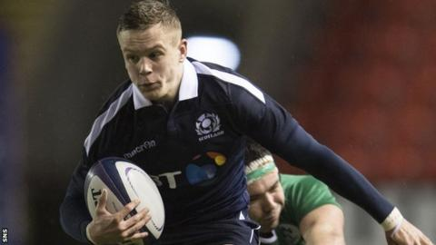 Darcy Graham carries the ball for Scotland U20s against Ireland