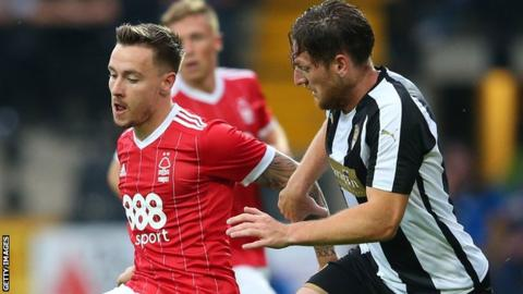 Barrie McKay of Nottingham Forest is challenged by Matt Tootle of Notts County during a pre-season friendly