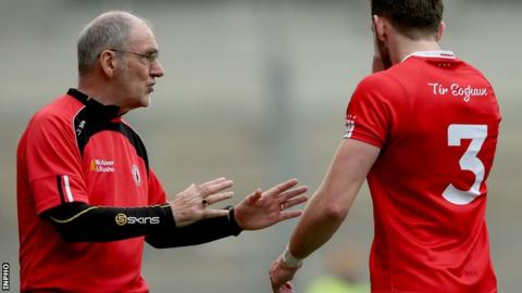 Mickey Harte talks to Ronan McNamee after the Tyrone players's sending off late in the win over Monaghan