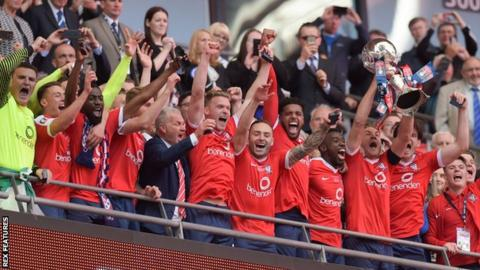 York City's players lift the FA Trophy
