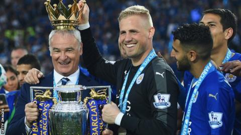 Leicester City manager and players celebrate winning the Premier League title
