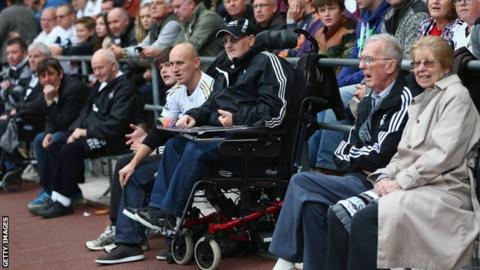 Disabled supporters watching a football match