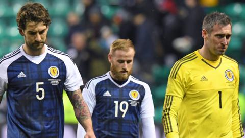 Charlie Mulgrew, Barry Bannan and Allan McGregor are left dejected at full time