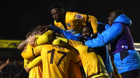 Sutton celebrate winning against Wimbledon