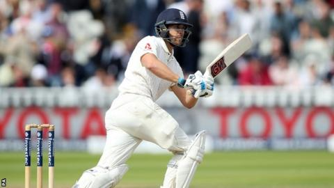 Rain holds up England after Cook makes 243