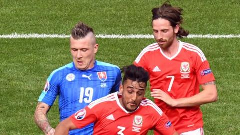 Neil Taylor has close support from Joe Allen against Slovakia at Euro 2016