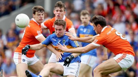 Armagh's Niall Grimley, Mark Shields and Stephen Sheridan surround Tipperary's Bill Maher