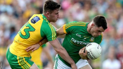 Patrick McBrearty of Donegal challenges Meath's Donal Keogan
